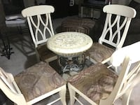 Four chairs and table base.