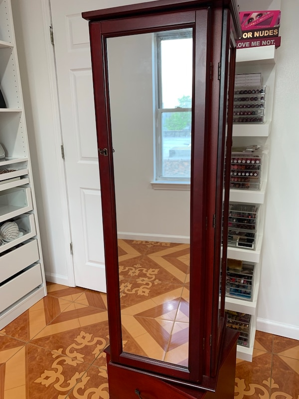 Jewelry armoire with mirrors