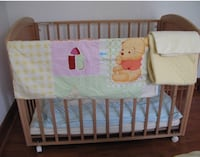 Wooden crib. Comes with mattres, duvet with 2 covers and protector mattress 29 km