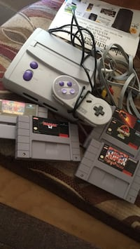 Gray Super Nintendo with cords controller and games will negotiate  Mendota, 61342