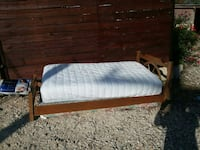 brown wooden bed with white mattress