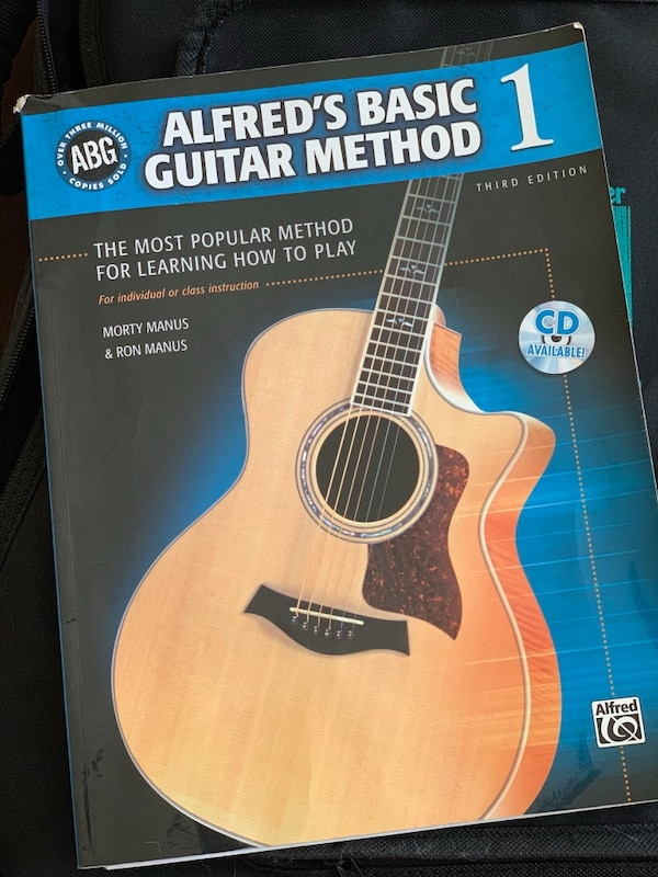 Black Acoustic Guitar with Carrying Case and Beginner's Instruction Manual cfef223d-7379-44b7-9b38-6bae24552d5a