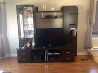 flat screen television with brown wooden TV hutch Mascouche, J7K 0C3