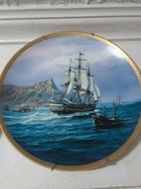 round brown wooden framed painting of sail boat Washington, 20009