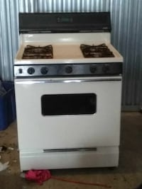 white and black 4-burner gas range oven