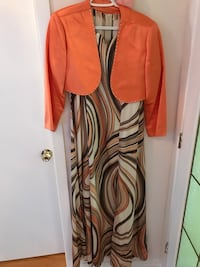Orange cardigan and mlticolored sleeveless dress