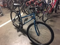 black and blue hardtail mountain bike Vancouver, V6J 3L1