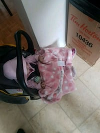 baby's pink and black car seat carrier Ottawa, K2G 4E9