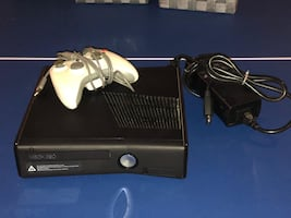 XBOX 360 with controller, games, and headsets