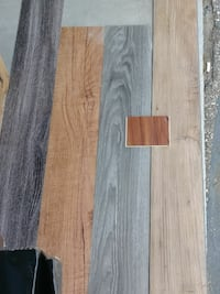 four brown, gray, and black wood planks