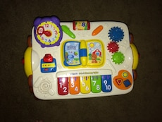 baby's white Vtech educational toy