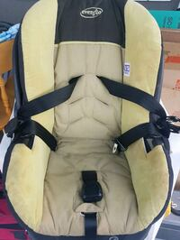 baby's white and black Evenflo car seat carrier Vancouver, V5M 2B7