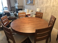 Round brown wooden table with six chairs dining set San Rafael, 94901