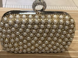 Pearl with gold colour