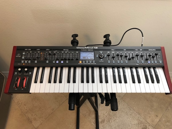 Behringer Deepmind 12 Polyphonic Analog Synth, 49 key, 12 voice, arpeg, mod  matrix and more  Excellent condition  Only 1 tiny nick on each end cheek