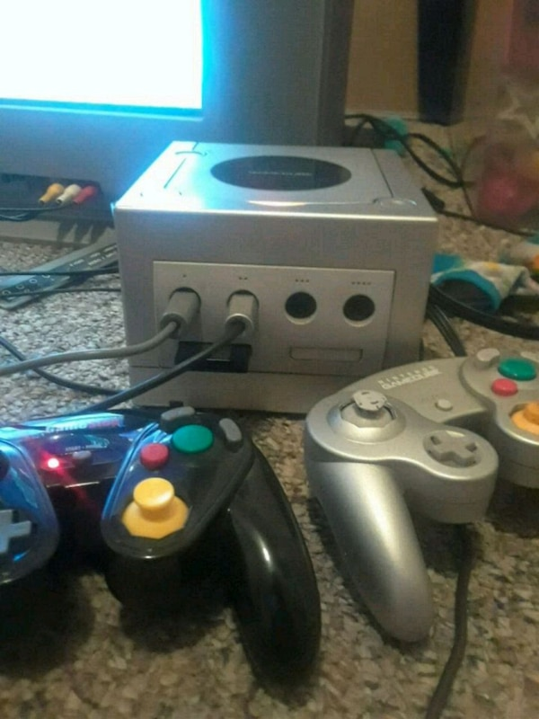 white Nintendo Gamecube console with controller