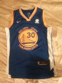 blue and white Golden States Warrior jersey