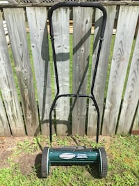 green and black Yardworks reel mower Tay, L0K