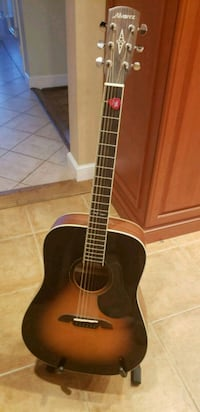Acoustic Guitar with case and stand