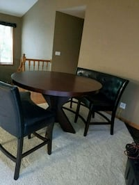 round brown wooden table with four chairs dining s Swisher, 52338