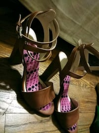 pair of brown-and-pink floral ankle-strap heels