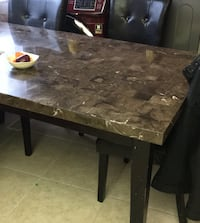 Marble table with 4 chairs one chair has tear Brampton, L6W 4S2