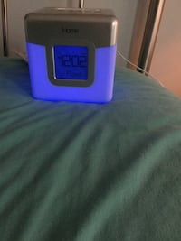Gray and purple iHome docking clock