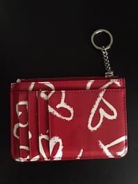 Kate Spade coin purse With card slot Condition: like new Size: 13x9 cm