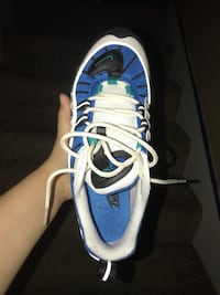 blue-and-white Nike running shoes 1135 mi