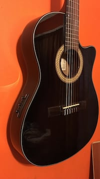 Ibanez slim classical guitar with tascam trainer  mint condition willing to trade for a nice laptop or tablet plus cash from you
