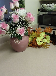 pink and white rose arrangement in brown vase