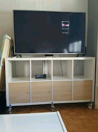 white wooden TV hutch with flat screen television Toronto, M4X 1P1
