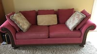 red fabric 2-seat sofa with throw pillows and ottoman 33 km