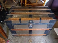 Antique flat top steamer trunk/coffee table