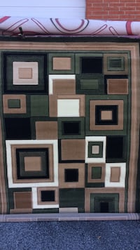 Brown, gray, and white area mat