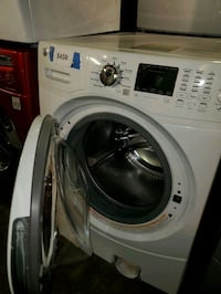 Ge front load washer NEW scratch and dent  Baltimore, 21223