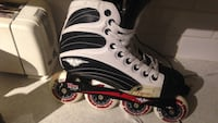 unpaired white and black inline skate Montreal, H1X 2S2