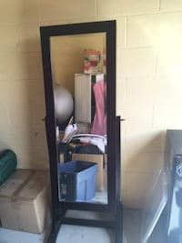 Black wooden framed glass display cabinet Kelowna, V1W 3S9