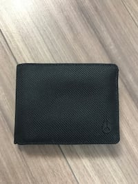 Black Volcom wallet never been used  Edmonton, T5T
