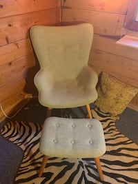 Green arm chair with foot stool