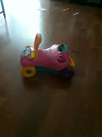 toddler's pink and green ride on toy