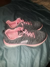 pair of gray-and-pink Skechers running shoes