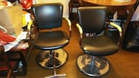 two black leather swivel chairs