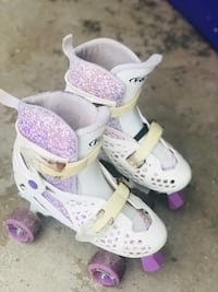 toddler's white-and-pink shoes