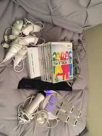 Wii console, 4 remotes, 5 nunchucks, 1 microphone, 7 wii games Washington, 20002