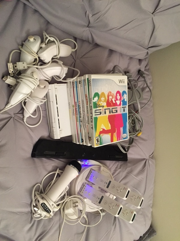 Wii console, 4 remotes, 5 nunchucks, 1 microphone, 7 wii games