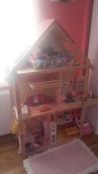 brown wooden toy house