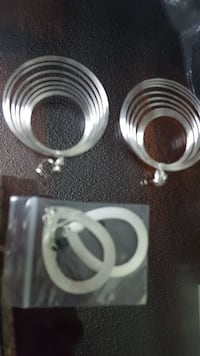 pair of silver-colored earrings