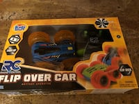 black and yellow racing car toy in box Freehold, 07728