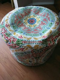 white, green, and red floral fabric ottoman 813 mi